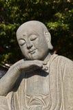 Schließen Sie herauf Schuß des Lächelnbuddha-Gesichtes Lizenzfreies Stockbild