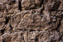 Schließen Sie herauf strukturierten Hintergrund einer Wand der mittelalterlichen Steinmaurerarbeit Die Wand ist errichtet von den Lizenzfreie Stockfotos
