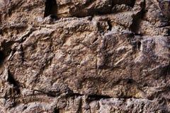 Schließen Sie herauf strukturierten Hintergrund einer Wand der mittelalterlichen Steinmaurerarbeit Die Wand ist errichtet von den Stockbilder