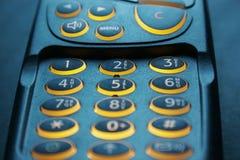 Schließen Sie oben auf Schlüsselauflage eines Telefons Lizenzfreie Stockfotografie