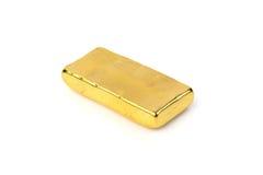 Schließen Sie oben vom Goldbarren auf weißem Hintergrund Lizenzfreie Stockfotografie
