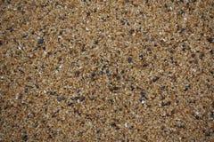 Schließen Sie oben vom goldenen, schwarzen und weißen Sandkorn stockfotografie