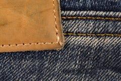 Schließen Sie oben vom Jeansaufkleber Lizenzfreies Stockbild