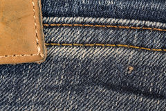 Schließen Sie oben vom Jeansaufkleber Lizenzfreie Stockfotos