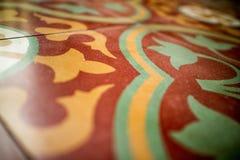 Schließen Sie oben vom Kolonialartmosaikfliesenboden stockbilder