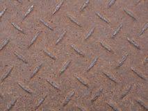 Schließen Sie oben vom Stahlrosthintergrund des materiellen Bodenbrauns Stockfotos