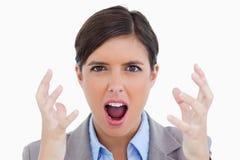 Schließen Sie oben vom verärgerten schreienden Unternehmer Stockfotografie