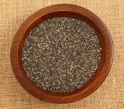 Schließen Sie oben von Chia Seeds In Wooden Bowl Stockfotos