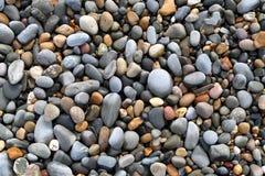 Schließen Sie oben von den bunten Steinen. Stockbilder