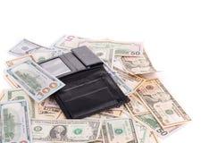 Schließen Sie oben von den Dollarscheinen und dem Geldbeutel Stockfoto