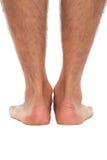 Schließen Sie oben von den Füßen eines Mannes von hinten Lizenzfreies Stockbild
