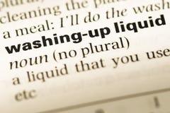 Schließen Sie oben von der alten englischen Wörterbuchseite mit Wortreinigung herauf Flüssigkeit lizenzfreie stockfotos