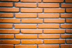 Schließen Sie oben von der Backsteinmauer des roten Lehms Stockfotografie