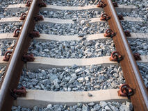 Schließen Sie oben von der Eisenbahn mit vielem Kies Lizenzfreie Stockfotos