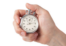Schließen Sie oben von der Hand, die Stoppuhr hält, lokalisiert auf weißem Hintergrund Lizenzfreies Stockfoto