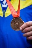 Schließen Sie oben von der olympischen Bronzemedaille Stockfotografie