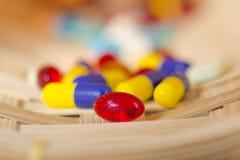 Schließen Sie oben von der roten Pille stockbilder