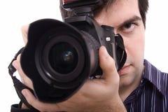 Schließen Sie oben von einem Fotografieren des jungen Mannes Stockfotos