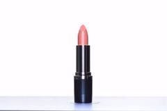 Schließen Sie oben von einem Lippenstift auf weißem Hintergrund Lizenzfreies Stockfoto