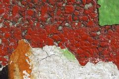 Schließen Sie oben von schmutzigem und zerbröckeln, rote Betonmauer Lizenzfreie Stockfotos