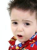 Schließen Sie oben von ToddlerBoy mit Umkippen-Ausdruck Stockbild