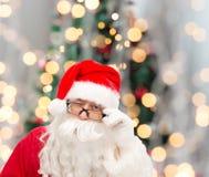 Schließen Sie oben von Weihnachtsmann-Blinzeln Stockfotos