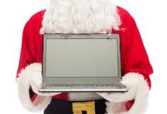 Schließen Sie oben von Weihnachtsmann mit Laptop Lizenzfreies Stockfoto