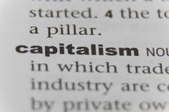 Schließen Sie oben von Wort Kapitalismus lizenzfreie stockfotos