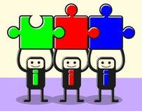 Schließen Sie sich Puzzlespielteamwork an Stockfoto