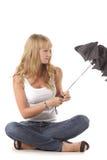 Schließender Regenschirm stockbilder