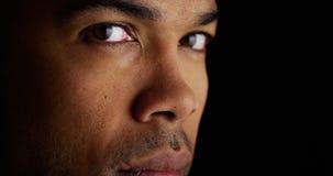 Schließen Sie oben auf dem Gesicht des schwarzen Mannes Lizenzfreie Stockfotografie