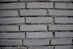 Schließen Sie oben vom alten getragenen Backsteinmauerhintergrund Gealterte schmutzige Steinwand gemasert Weinlese-Effekt Stockbild