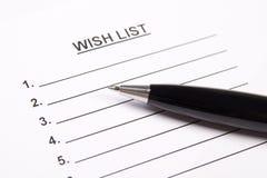 Schließen Sie oben von der leeren Wunschliste und vom Stift Stockfotografie