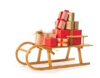Schlitten mit Weihnachtsgeschenken Stockfotos