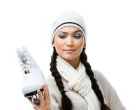 Schlittschuhläufer der weiblichen Abbildung betrachtet durchdacht den Rochen Lizenzfreie Stockbilder