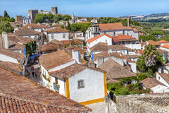 Schloss-Drehkopf-Turm-Wand-Orange überdacht Obidos Portugal Stockfotos