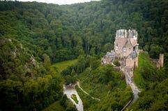 Schloss in einem Wald Lizenzfreies Stockbild