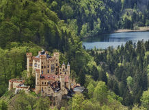 Schloss Hohenschwangau. With lake and forest, the castle viewed from above Royalty Free Stock Images