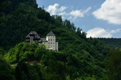 Schloss Klaus, Oberosterreich, Austria. Historic building Klaus castle on the hill above Klaus dam in Upper Austria royalty free stock photo
