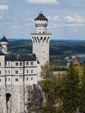 Schloss Neuschwanstein, front tower. Front tower of Neuschwanstein castle, with the rampart of the castle, and the Bavarian landscape in the background Royalty Free Stock Photography