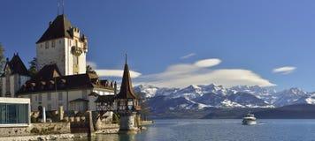 Schloss Oberhofen with a boat on Thun Lake, Switzerland Stock Photo