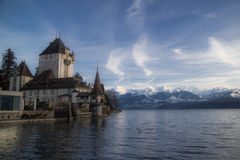 Schloss Oberhofen. Oberhofen Palace with alps mountain view by the lake Brienz. Switzerland travel. Currently used as museum Stock Image
