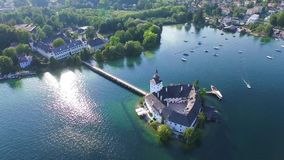 Schloss Orth. Sail, Schloss Orth is a castle situated on lake Traunsee in Gmunden Austria, alps, Salzburg stock footage