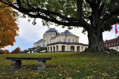 Schloss solitude in fall, stuttgart. Autumnal foresight of the famous castle located in a park in surroundings of the city, to the fore a bench and centuries-old Stock Photos