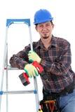 Schlosser mit Bohrgerät, weißer Hintergrund Stockbild