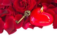 Schlüssel mit dem Kerzenherzen Stockbilder