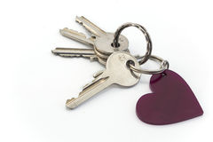 Schlüssel und Herz lokalisiert auf Weiß Lizenzfreie Stockbilder