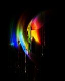 Schmelzende Farben, tropfender Regenbogen Stockfotografie
