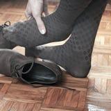 Schmerz in den Füßen Stockfoto