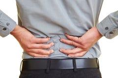 Schmerz in der Rückseite Lizenzfreie Stockfotos